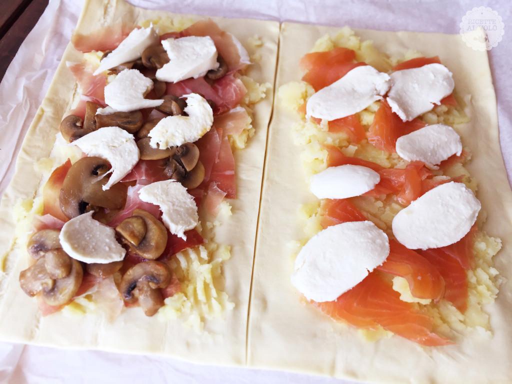 Rotoli di pasta sfoglia ripieni ai funghi e salmone